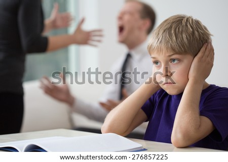 Young couple is arguing to loud alongside their child - stock photo