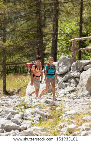 Young couple is doing trekking in the mountains