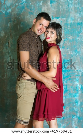 Young couple is embracing. Man and woman together. Family and relationships. Indoors in the studio. - stock photo
