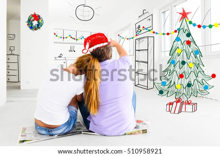 young couple is planning christmas or new year decoration of their new apartments
