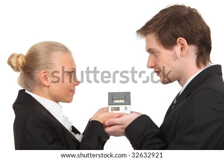 young couple isolated holding home. profile - stock photo