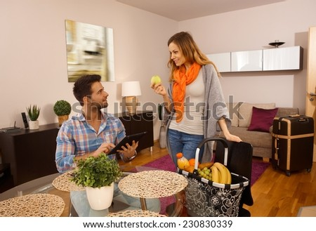 Young couple just arrived in holiday apartment. - stock photo