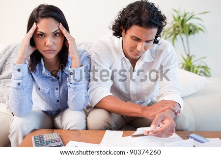 Young couple just found out they are broke - stock photo