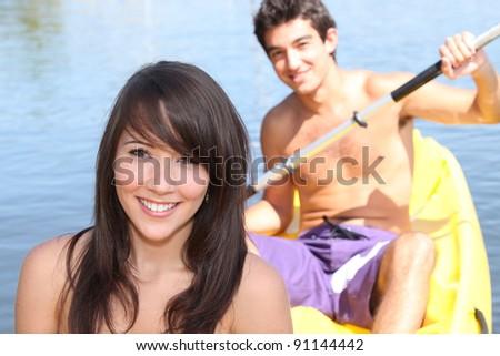 Young couple kayaking - stock photo