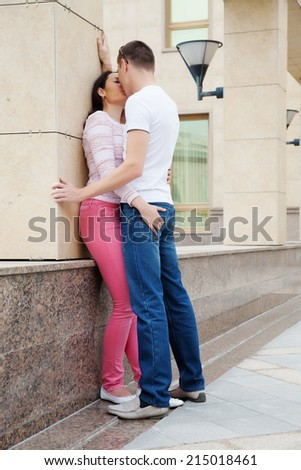 Young couple kissing each other outdoor - stock photo