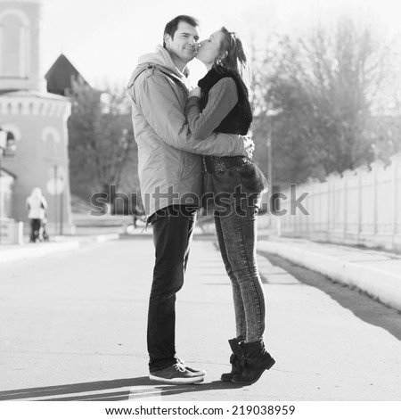 Young couple kissing in autumn city