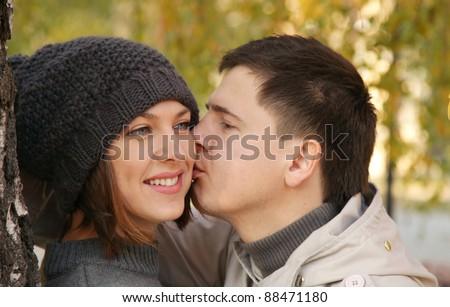 Young couple kissing in the autumn park