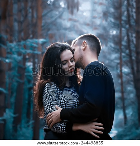 young couple kissing on a cold background - stock photo