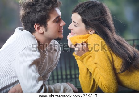 Young couple kissing, outdoors - stock photo