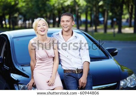Young couple laughing in car