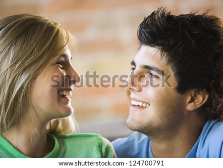 Young couple laughing together - stock photo