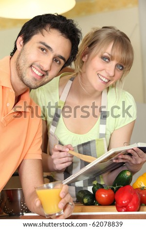 Young couple looking at a cookbook