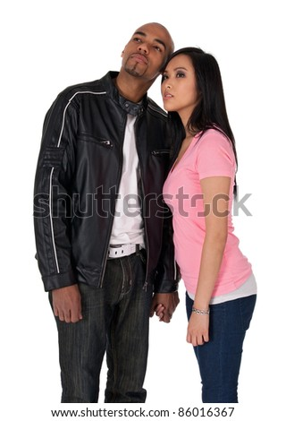 Young couple looking in one direction - African American guy with Asian girlfriend. - stock photo