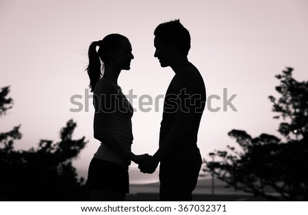 Young couple looking into each others eyes.  - stock photo