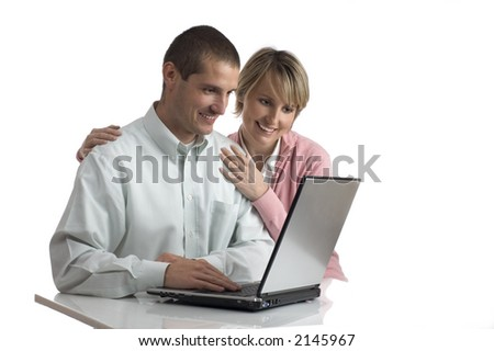 young couple looking on the laptop screen - stock photo