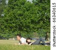 Young couple lounging in grass - stock photo