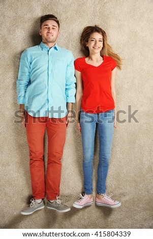 Young couple lying on the floor - stock photo