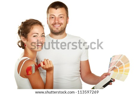 Young couple making repairs in the paint, isolated on white background