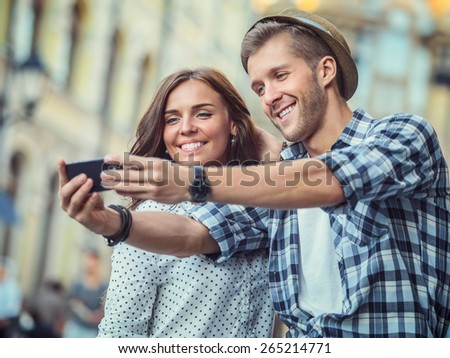 Young couple making selfie - stock photo