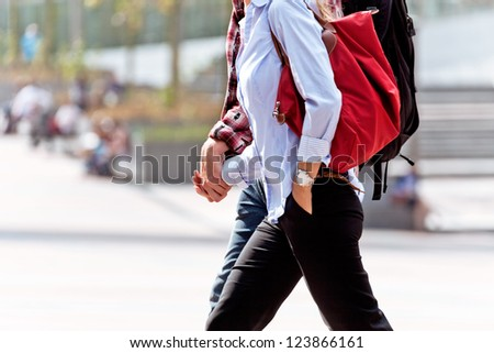 Young couple. Man and woman after work. Urban scene.