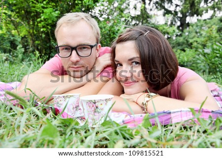 Young Couple Man and Woman Laying On Picnic - stock photo
