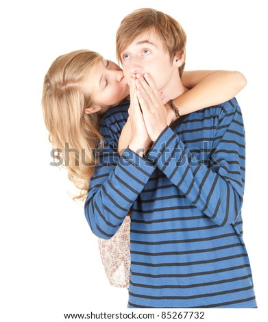 young couple - man kissing his beautiful girlfriend, white background - stock photo