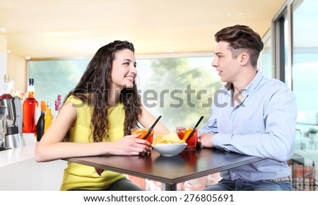 Young couple meet at the bar for drink a cocktail - stock photo