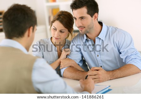 Young couple meeting construction planner - stock photo