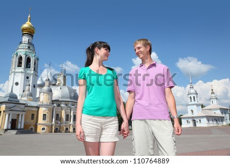 Young couple near Holy Resurrection cathedral, Alexander Nevsky church on Kremlin square in Vologda, Russia - stock photo