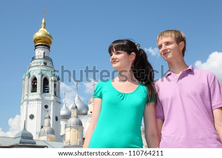 Young couple near Holy Resurrection cathedral in Vologda, Russia - stock photo