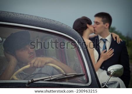 Young couple next retro car - stock photo