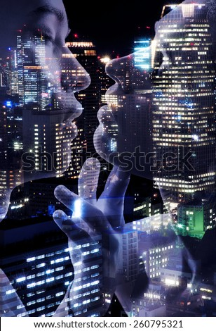 Young couple of lovers kissing on night lights Tokyo background - stock photo