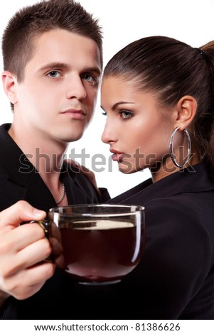 Young couple of man and woman drinking tea - stock photo