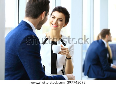 Young couple of professionals chatting during a coffee break - stock photo