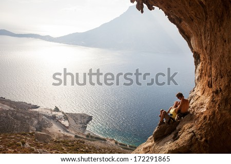 Young couple of rock climbers having a rest. Kalymnos Island, Greece.  - stock photo