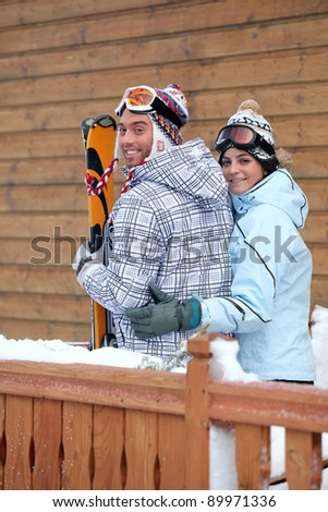 Young couple of skiers - stock photo