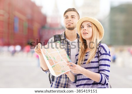 Young couple of travelers outdoors
