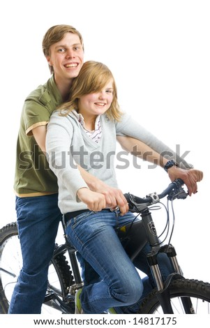 Young couple on a bicycle isolated on a white background