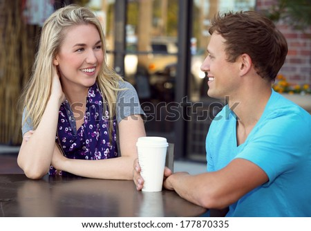 Young couple on a coffee date - stock photo