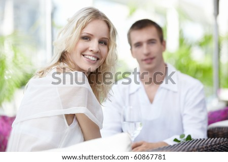 Young couple on a date in a cafe - stock photo