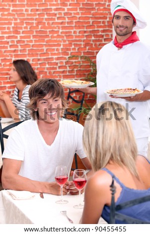 Young couple on a date in a pizzeria. - stock photo