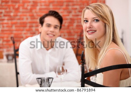 Young couple on a date in a restaurant - stock photo