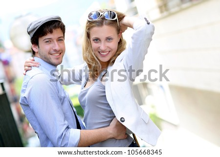 Young couple on a date in town - stock photo