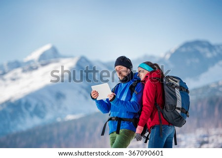 Young couple on a hike - stock photo