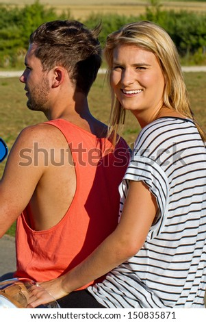Young couple on a motorbike - stock photo