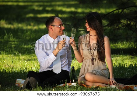 Young couple on a romantic picnic in the park