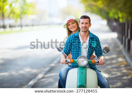 Young couple on a scooter outdoors