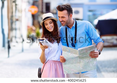 Young couple on a sightseeing tour in Europe  reading guide