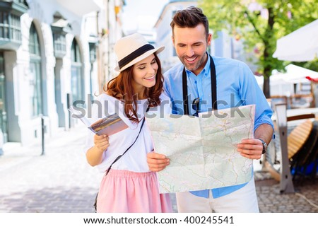 Young couple on a sightseeing tour in Europe  reading map