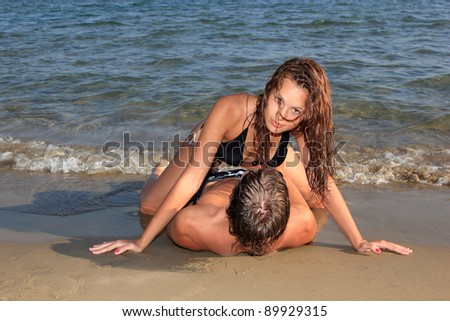 Young Couple on a the beach - stock photo